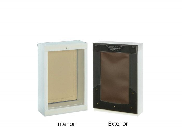 Interior/exterior view of small Freedom Pet Pass wall-mounted pet door with chocolate/tan flap